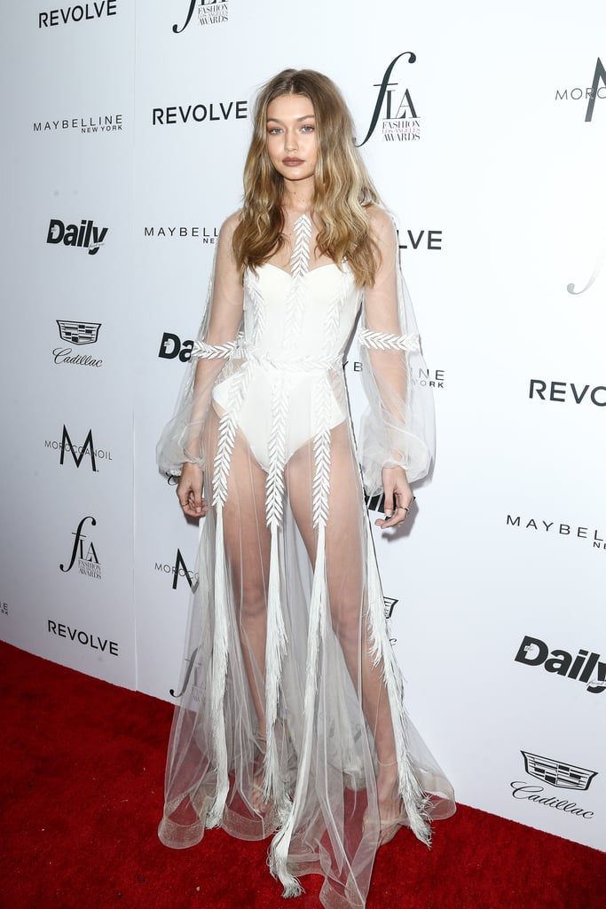 Wearing a sheer Yanina Couture gown over a La Perla bodysuit at the ...