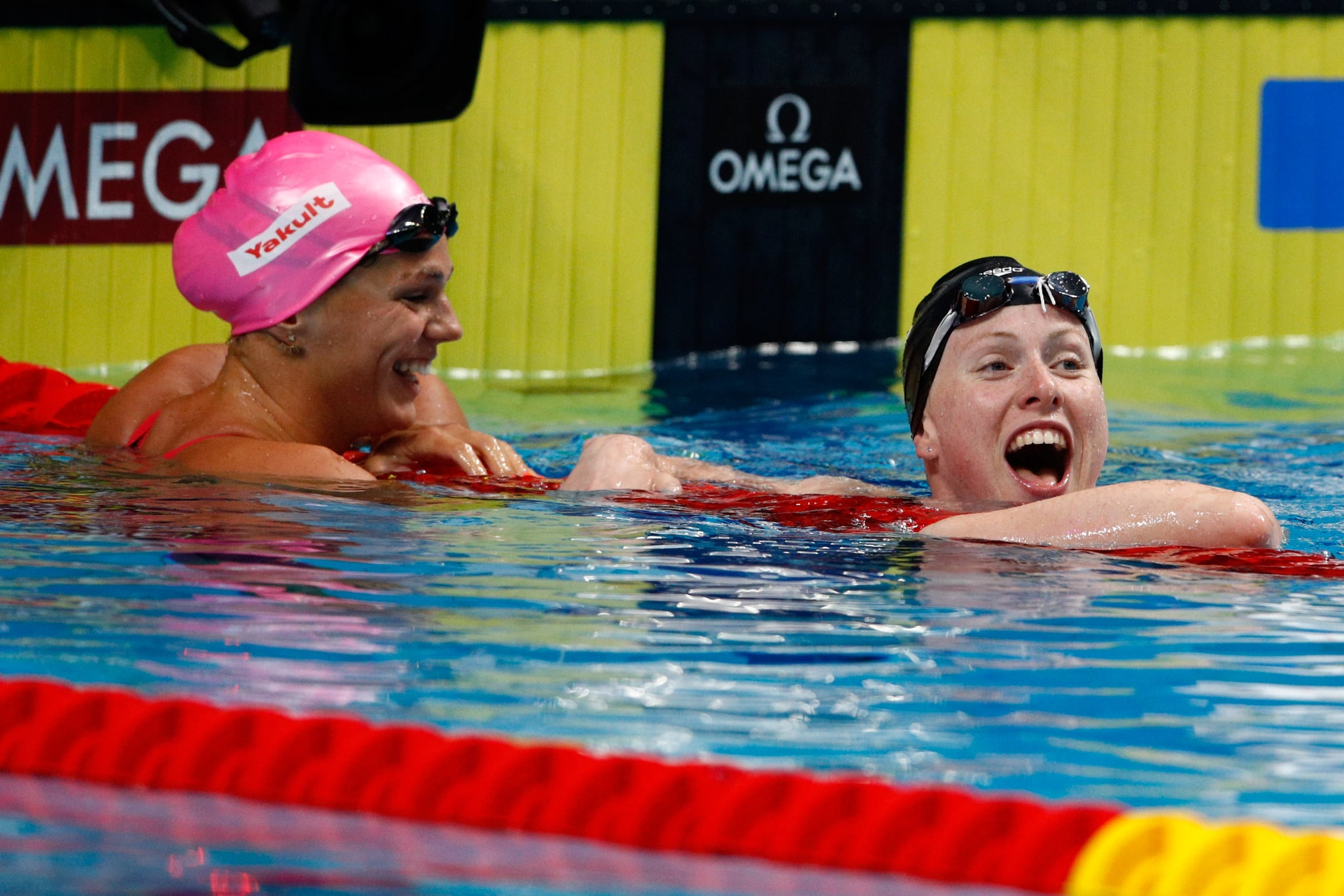 BUDAPEST, HUNGARY - JULY 30:  Lilly King of the United States (R) celebrates victory and a new World Record of 29.40 in the Women's 50m Breastsroke Final on day seventeen of the Budapest 2017 FINA World Championships on July 30, 2017 in Budapest, Hungary.  (Photo by Adam Pretty/Getty Images)