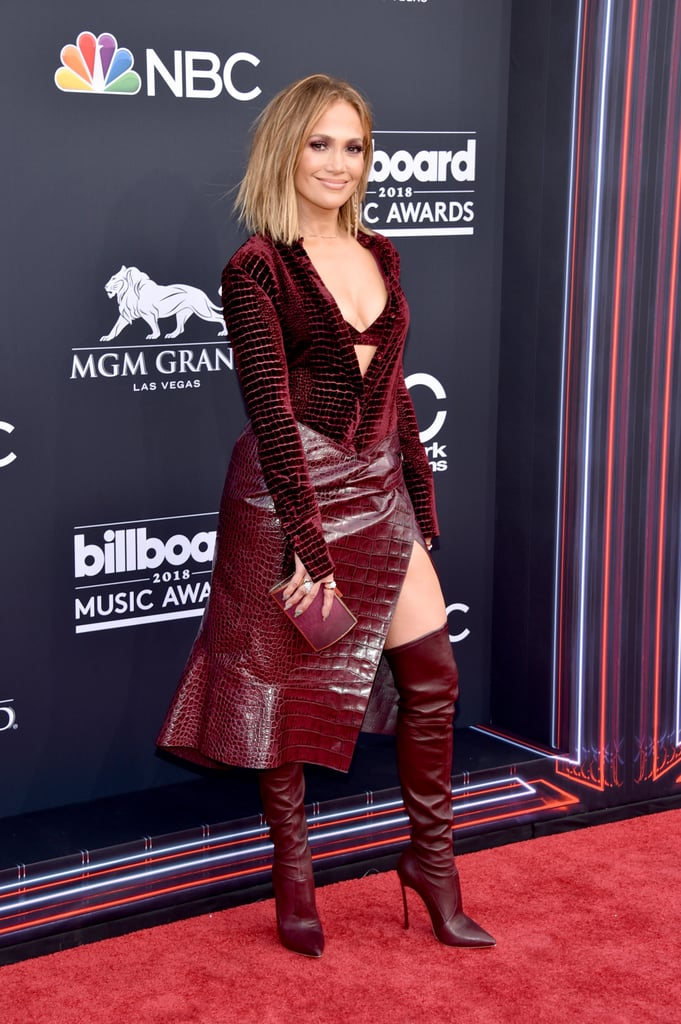 """Fact: Jennifer Lopez will never stop being our girl crush. The 48-year-old made this very clear at the 2018 Billboard Music Awards. Not only did she make us scream """"yaaas, queen!"""" when she walked the red carpet in an oxblood ensemble which resembled crocodile skin — seriously, only she could pull that off — but the mum of two also hit the stage later that evening to perform her song """"Dinero"""" for the first time with DJ Khaled. Talk about a timeless talent and beauty. Bask in the glow that is J Lo with these photos of her BMAs look ahead, then check out who took home trophies at the ceremony.        Related:                                                                                                           The Billboard Music Awards Red Carpet Is Sexy as Hell —It's Vegas, Baby!"""