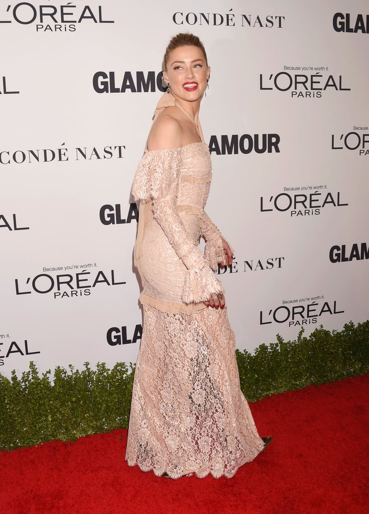 Amber Heard might have started off the year with a highly-publicized, painful divorce from husband Johnny Depp, but it appears that she's back on top. The Aquaman actress, who recently made her photo debut as the badass Mera, strutted her stuff at Glamour's Women of the Year awards in LA on Monday. She arrived to the empowering event at NeueHouse Hollywood in a delicate lace gown and a bright smile, bringing a bit of old Hollywood to the red carpet. Amber has been keeping a low profile since her split from the Pirates of the Caribbean actor — especially after going public about the domestic abuse she endured at his hands — but with press for Justice League and Aquaman coming up, hopefully this is the start of countless more gorgeous appearances from her.