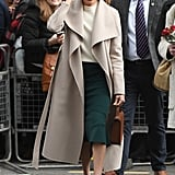 Meghan Markle Fall Outfit Idea: A Cream Sweater, Pencil Skirt, Belted Trench, and Chocolate Heels and Bag