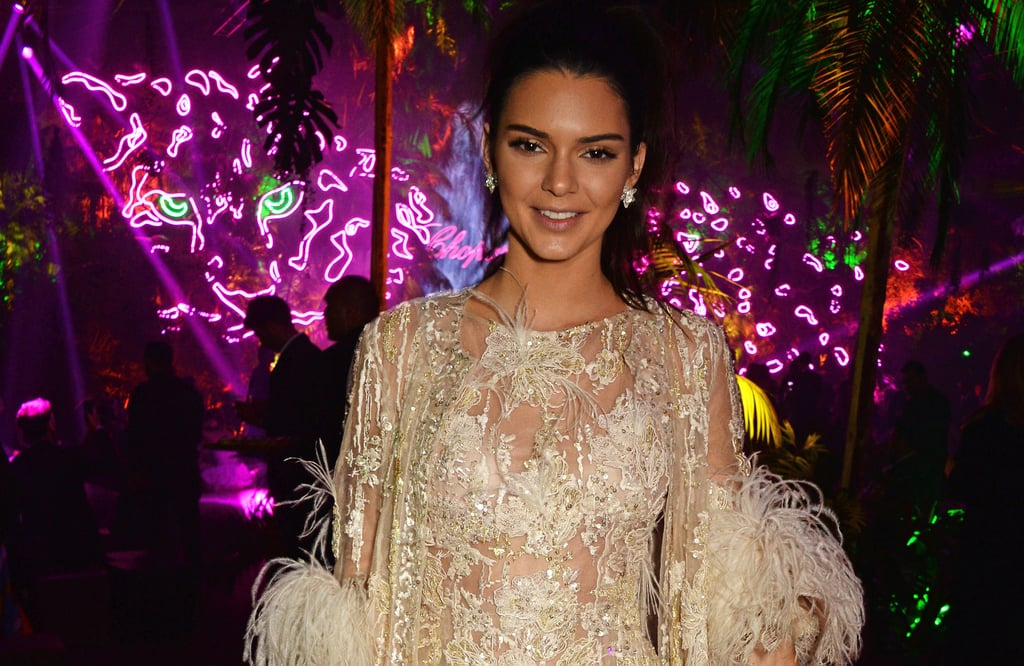 Kendall Jenner is back in Cannes and ready to party! The 20-year-old model and reality TV star arrived in the South of France last week, just in time to soak up the sun and glamour of the Cannes Film Festival. On Thursday, Kendall was spotted wearing all white for a Magnum Ice Cream photocall and was also seen enjoying the views from her hotel balcony with her mom, Kris. Later that evening they hit the red carpet together, and on Friday, Kendall sported a one-piece swimsuit while talking on her phone. Over the weekend, the model linked up with Heidi Klum at a Vanity Fair party and turned heads when she attended the From the Land of the Moon premiere in a sexy, sheer gown. This week, Kendall made waves at the Chopard party, where she linked up with mom Kris Jenner and Scott Disick.