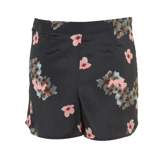 "Topshop Black Blossom Print Shorts, $66    Pair with:    <iframe src=""http://widget.shopstyle.com/widget?pid=uid5121-1693761-41&look=3445527&width=3&height=3&layouttype=0&border=0&footer=0"" frameborder=""0"" height=""244"" scrolling=""no"" width=""286""></iframe>"