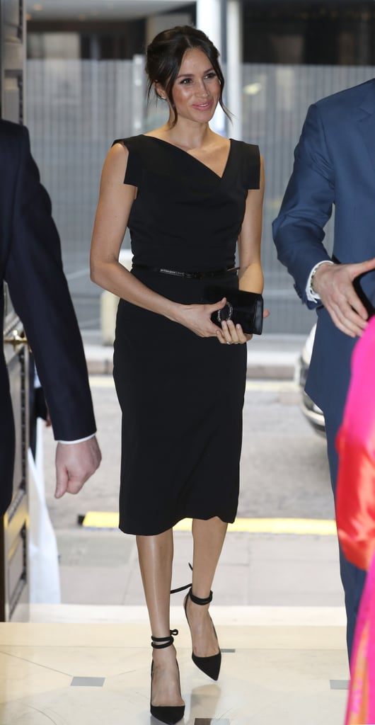 "Meghan Markle's royal wardrobe is shaping up to contain a nice collection of dresses. After debuting this Altuzarra pinstripe number, Meghan wore a Black Halo dress  (£420) to the Women's empowerment reception at the Commonwealth Heads of Government Meeting on April 19. The midi number featured an asymmetrical neckline and came with a belt to cinch in her waist. Dubbed the ""Jackie O"" dress by the brand, it contained all the sophisticated details perfect for royals attending more formal occasions. Meghan carried a black clutch in her hand and swept her hair up to reveal a pair of simple diamond earrings. As for her shoes, she stuck to her go-to choice of strappy heels. She wore a pair of lace-up pumps from Aquazzura. Read on to see her entire outfit, and then shop her exact dress.      Related:                                                                                                           This Is What the ""Meghan Markle Effect"" Looks Like For Fashion Brands — and It's Kind of Nuts"