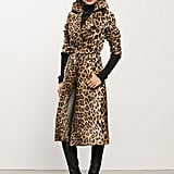 Leopard Calf Skin Trench ($4,495), Cashmere Black Turtleneck Sweater ($495), Sweet Revenge Black Leather Legging Boot ($1,995) Photo courtesy of Tamara Mellon