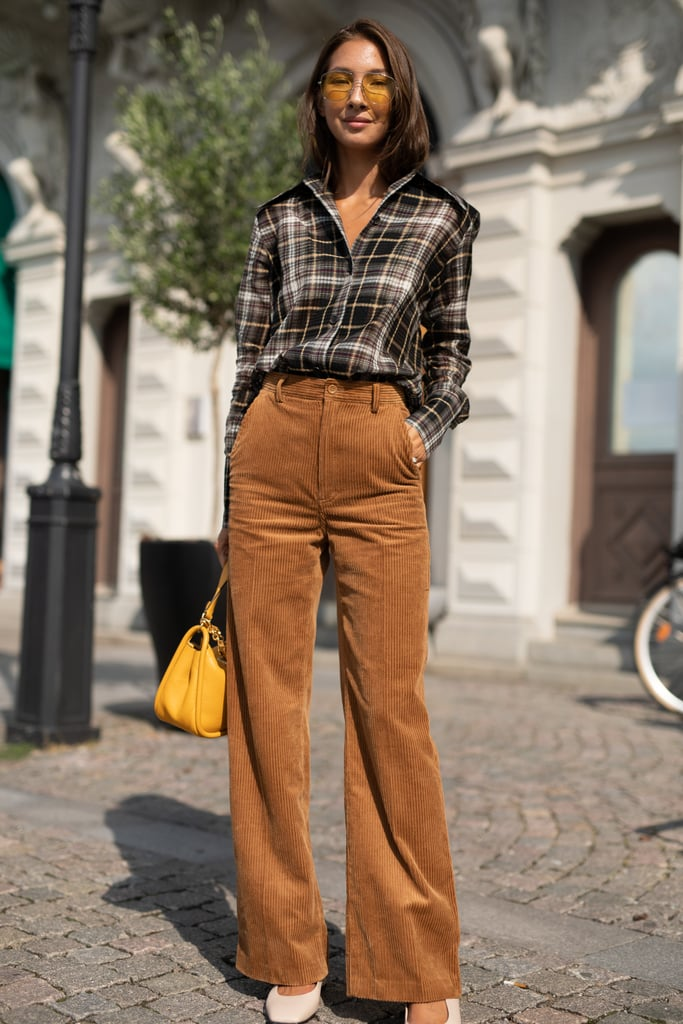 Keep things classic in a plaid button-down and trousers.