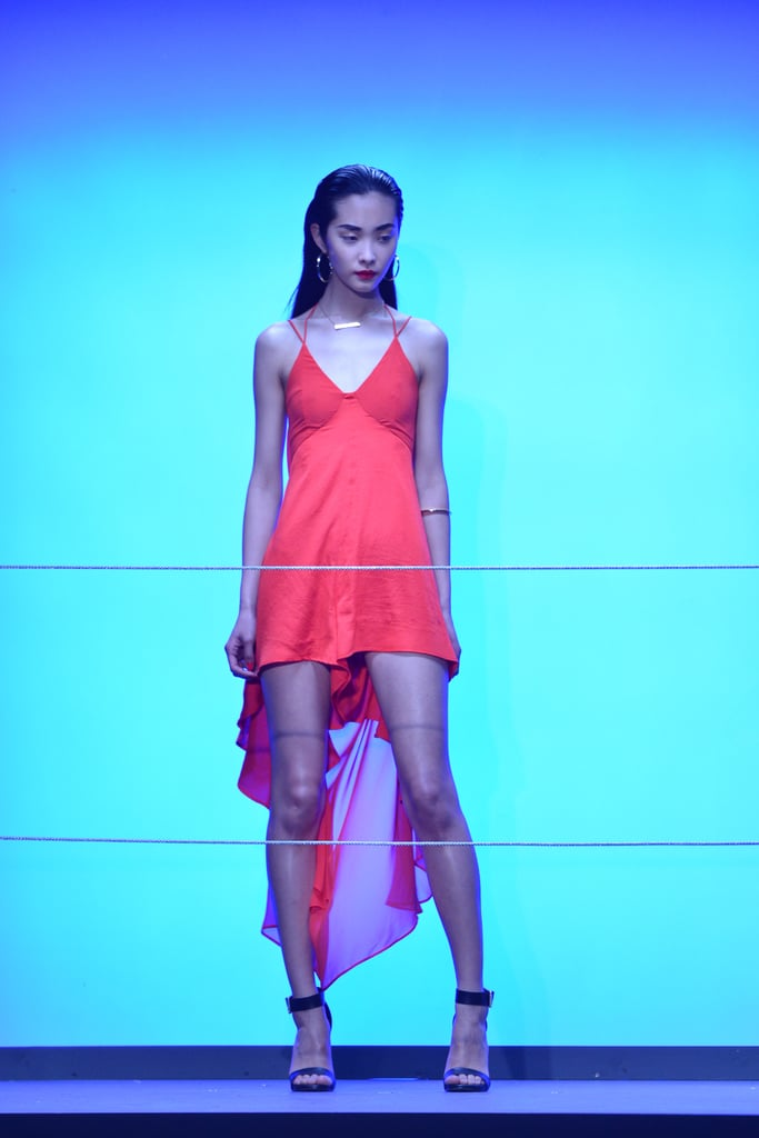 A dramatic high-low hem — in a bright coral hue — was introduced at the Rihanna For River Island Fall 2013 presentation.