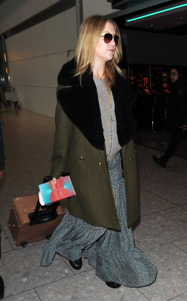 """Kate Hudson kept her baby bump covered up as she arrived at Heathrow with Matt Bellamy today. The couple's pregnancy joy was revealed earlier this month, and out of all the other mums-to-be you found Kate's announcement the most surprising. Her mum Goldie Hawn in also in London, attending the British Comedy Awards last night, and she confirmed that the couple are expecting a baby, saying: """"I'm excited! It's exciting. You know, we're just all very happy... happy for them both. What's more to say?"""" Kate kept her clothing casual for her flight: take a look back at her past pregnancy style in anticipation of what she wears this time."""