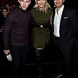 Nick Jonas, Rita Ora, and Ryan Seacrest huddled together at Z100's Jingle Ball concert in NYC on Friday.