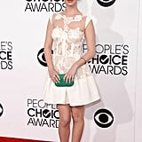 Australian actress Adelaide Kane picked a white lace, illusion-neckline dress and strappy sandals, punctuated with an emerald green clutch.