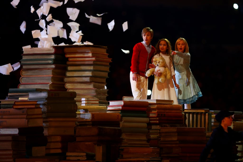 Kids looked on as pages fell over the piles of books.