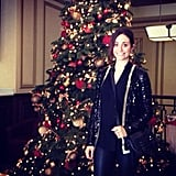 Emmy Rossum posed in front of a decked-out Christmas tree.  Source: Instagram user emmyrossum
