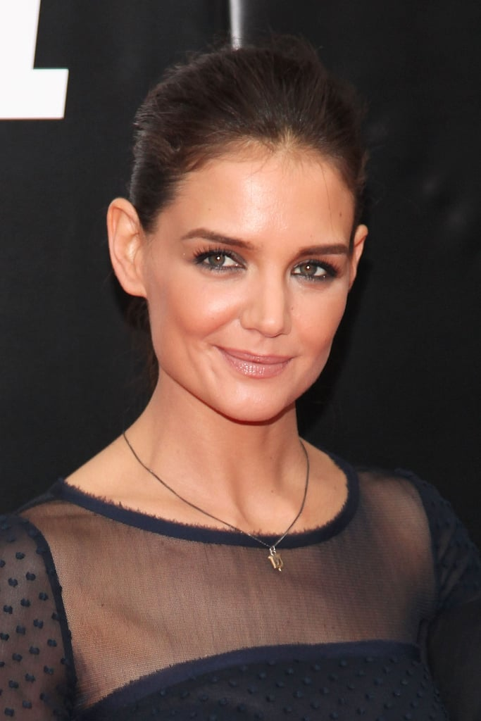Katie loves her eyeliner, and at the Ghost Protocol premiere 2012, she had some fun with it. The actress paired her smudged navy liner with a simple ponytail, making for a sophisticated finish.