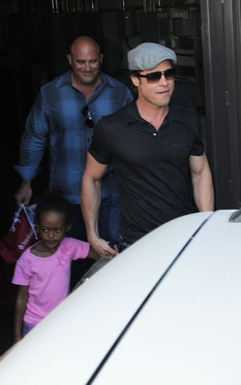 Brad Pitt escorted daughter Zahara over to The Grove shopping complex in Los Angeles, CA on Saturday afternoon (September 25).