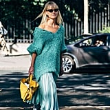 Wear an oversize sweater to dress down a feminine, full skirt.