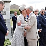 Kate and her father-in-law hugged during a 2017 outing while Prince William stood nearby.