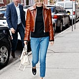 A Black Sweater, Jeans, and Brown Leather Jacket in NYC in September 2017
