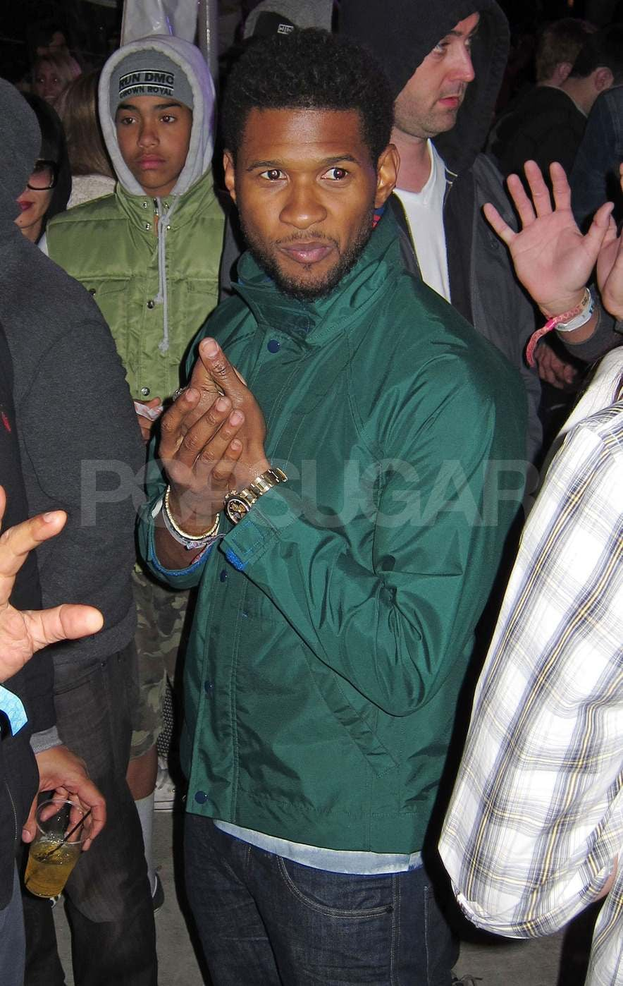 Usher and his friends checked out the scene on Saturday and later headed to Armani Exchange's Neon Carnival.