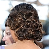 The back of her hair was intricately curled and twisted into an up 'do.