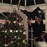Egypt Dean soared to new heights to place the star on the top of the tree (with a little help from his dad, Swizz Beatz, and his mom, Alicia Keys).