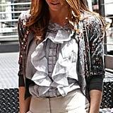 Jessica in an Oscar de la Renta cardi and ruffle blouse.