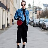 An All-Black Outfit Worn With a Denim Jacket and a Red Bag