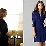 Wear Serena's Catherine Malandrino Longsleeve Navy Lace Dress ($395) — which she wore with Jean-Michel Cazabat's velvet-embellished pumps — with a long beaded necklace, like she does in this scene, or throw on a rhinestone necklace for shiny impact. For a work-appropriate version, wear black tights, booties, and a black blazer to sharpen things up.