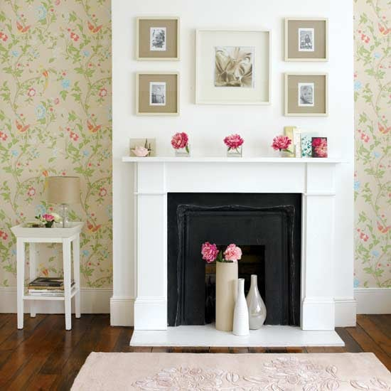 Place vases of flowers on top of and in front of the fireplace to bring Summer into this space.   Source