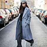 With a Turtleneck, Wide-Leg Trousers, a Long Coat, and a Beret