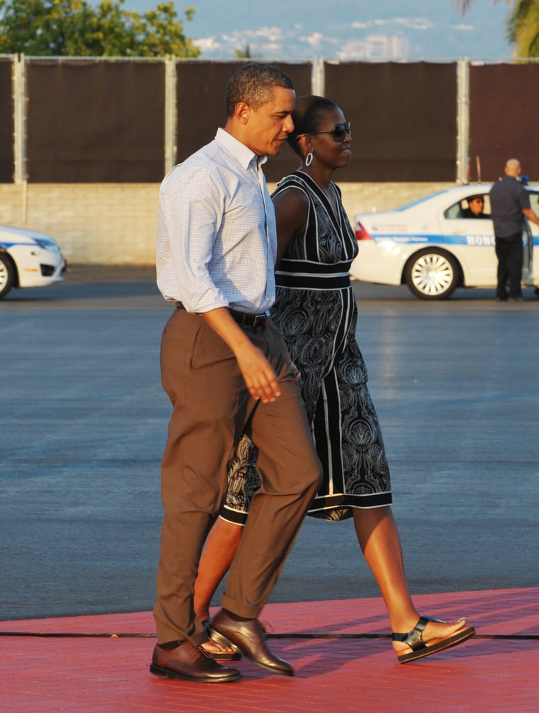 Michelle wearing a striped tunic dress and sandals in Honolulu.