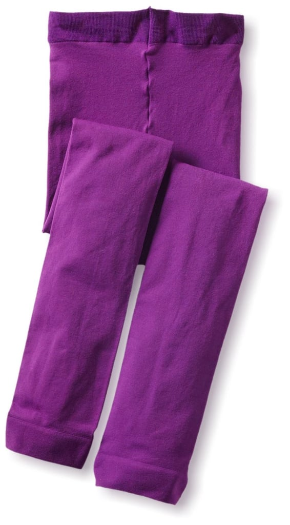 She can wear these purple footless tights ($10) for a fun, subtly festive look.