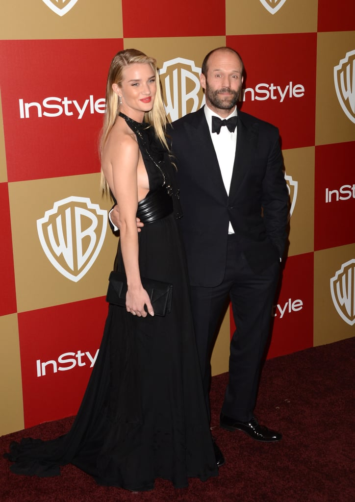 Rosie Huntington-Whiteley and Jason Statham smiled for photos.