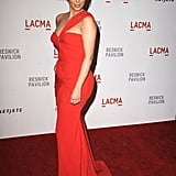 Kim Kardashian in a red, one-shouldered gown.