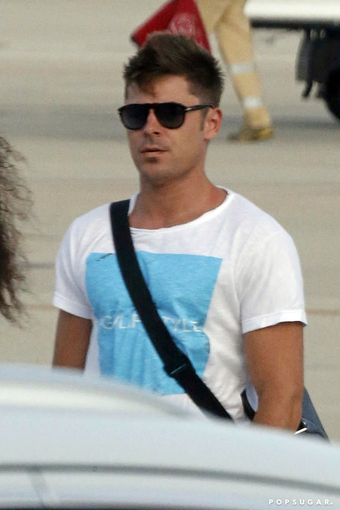 Zac's tan was on display at the airport.