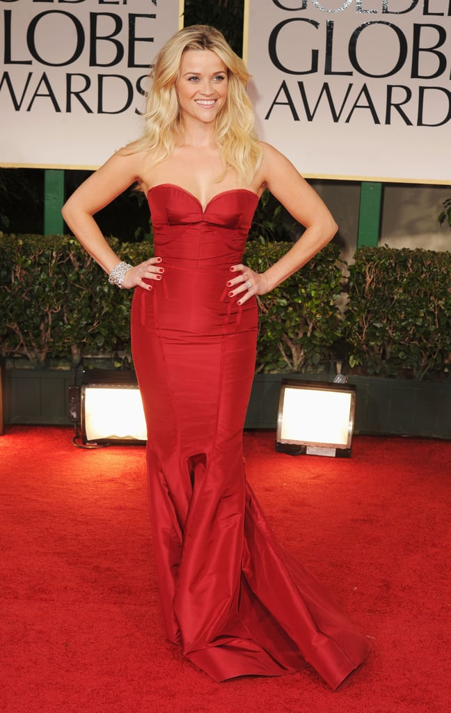 Reese Witherspoon was red hot in a Zac Posen gown today for the Golden Globes! She doesn't have a project in the running, but she is out and about raising the profile of her upcoming comedy This Means War, which also features her co-stars Chris Pine, Tom Hardy and Chelsea Handler. Reese is one of today's presenters, though, and we'll soon get to see her onstage between quips from host Ricky Gervais. We're excited for the fun to begin, but first, make sure you vote on all of our beauty and fashion polls!