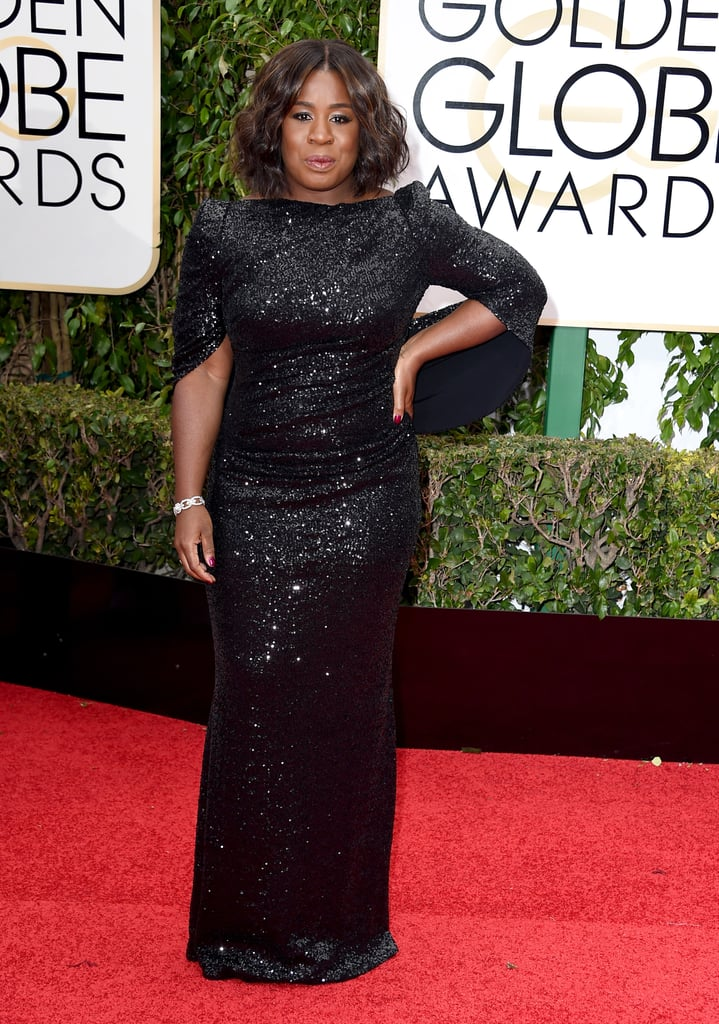 Uzo Aduba in a black gown with cape-back details