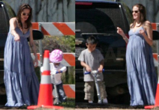 Images of Pregnant Angelina Jolie and Maddox and Zahara on scooters