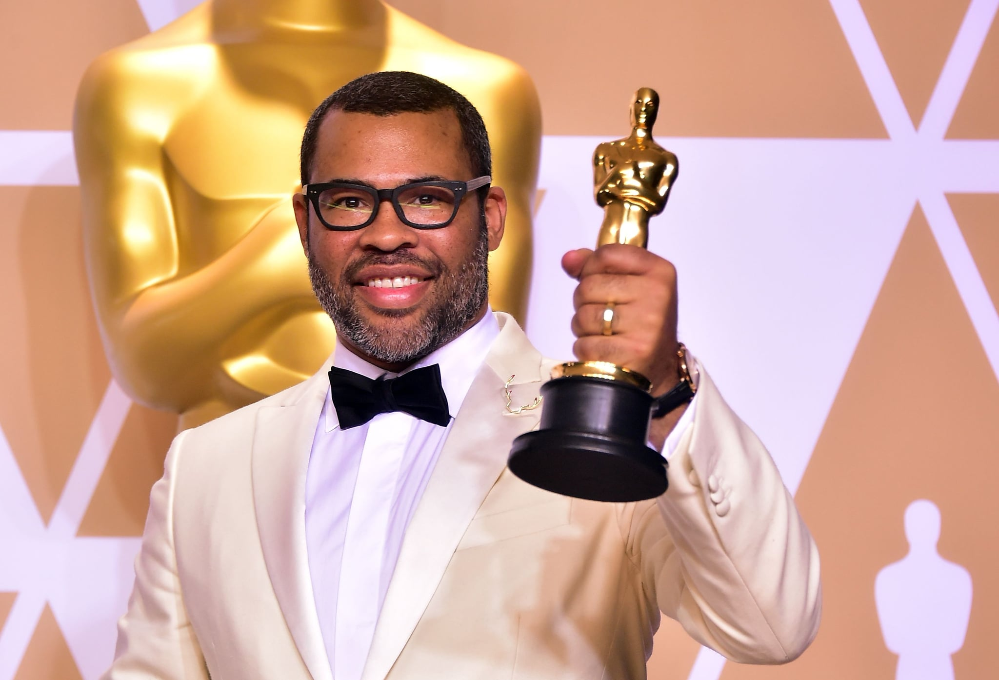 TOPSHOT - Director Jordan Peele poses in the press room with the Oscar for best original screenplay during the 90th Annual Academy Awards on March 4, 2018, in Hollywood, California.  / AFP PHOTO / FREDERIC J. BROWN        (Photo credit should read FREDERIC J. BROWN/AFP/Getty Images)