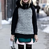 Natalie Joos bundled up with pretty pink accents and patterned knits.