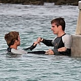Sam Claflin and Josh Hutcherson on the set of Catching Fire.