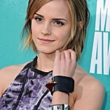 Emma Watson lent a tough-girl touch to her look via studded leather cuffs.