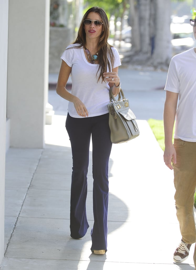 Sofia Vergara went shopping with a friend in West Hollywood yesterday. She stepped out just a day after filming on the fourth season of Modern Family got started in LA. Sofia was on set with her onscreen son, Rico Rodriguez, whose 14th birthday coincided with the first day of production. The cast is back to work following contract negotiations that ended with Sofia, Julie Bowen, Ty Burrell, Jesse Tyler Ferguson, Ed O'Neill, and Eric Stonestreet all receiving raises. It's just one more cause for celebration for Sofia, who recently marked her 40th birthday, got engaged to boyfriend Nick Loeb, and was nominated for a best supporting actress Emmy. She was also just named the winner of our 2012 PopSugar Bikini Bracket — check out Sofia's hottest bikini moments!