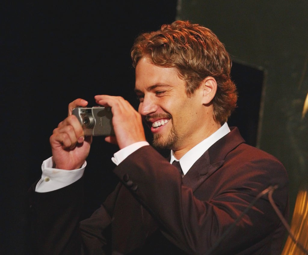Paul Walker smiled while snapping photos at the Hollywood Film Festival Awards in August 2001.