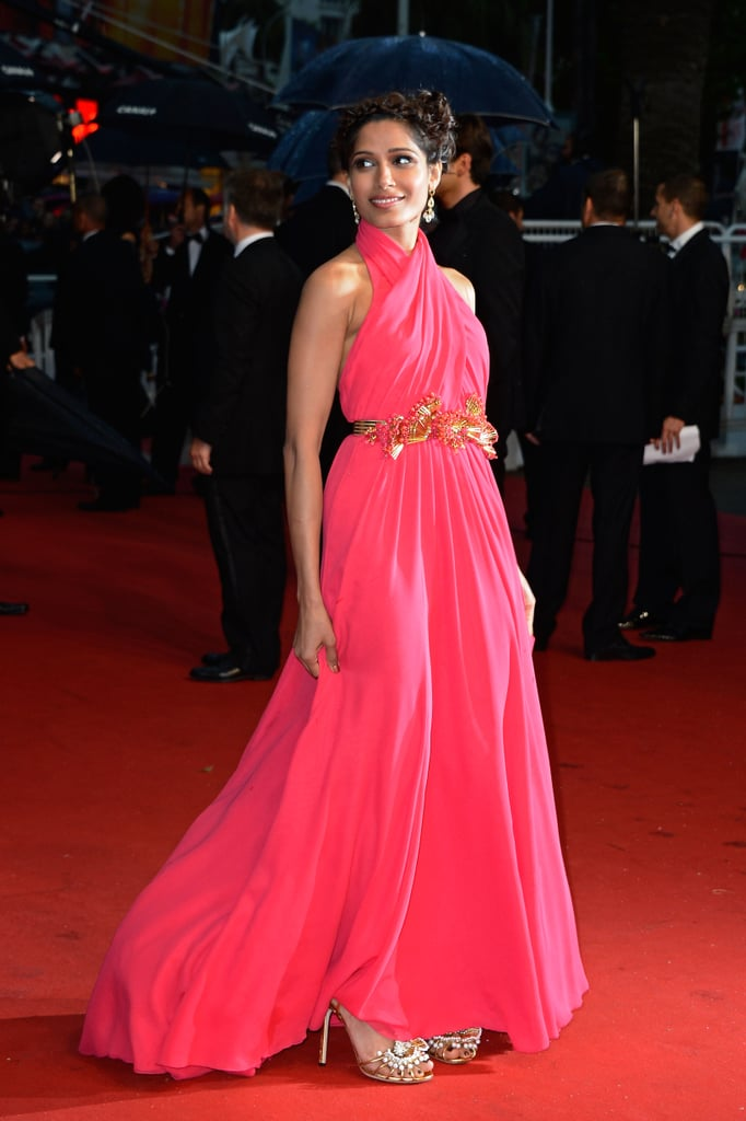 Freida Pinto accessorized her draped one-of-a-kind Gucci gown with shimmering jewelry from Chopard.