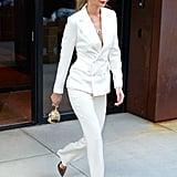 Gigi Hadid White Suit and Bear Bag