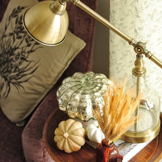 The finds: a few decorative pumpkins and a brass lamp.
