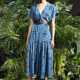 While she has only been spotted in Veronica Beard pants and shorts, we'd love to see Meghan wear one of the designer's gorgeous dresses. This printed blue number would be perfect for a day at the polo, and we're pretty sure Meghan would love the thick belt.