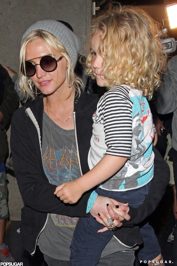 Ashlee Simpson carried Bronx Wentz as she made her way through the airport.