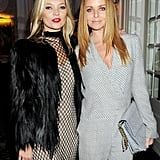 Kate Moss wore a bright red lip while Stella McCartney went with a nude shade.