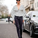 Go casual-chic in a polka-dot top and black skinny jeans.